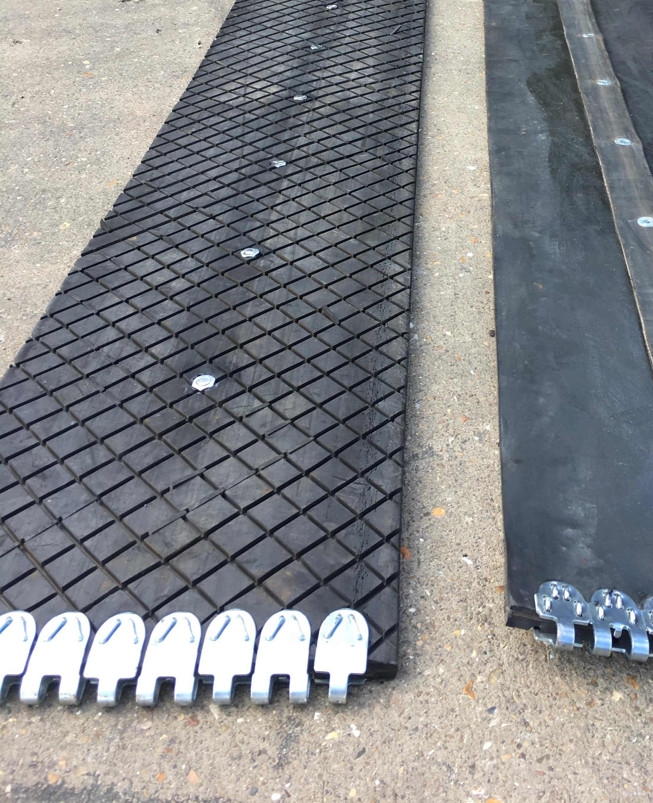 Custom rubber flat protection tracks for heavy machinery.